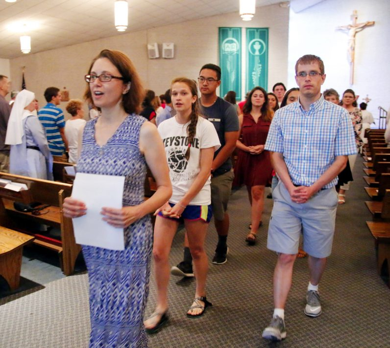 After receiving a blessing at the end of Mass, the young pilgrims headed to World Youth Day in Poland lead the recessional at St. Isaac Jogues Parish in Wayne. (Sarah Webb)