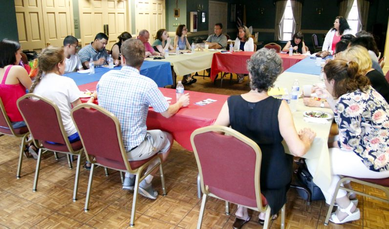 The young people and their parents meet for a meal and last-minute planning at St. Isaac Jogues July 17 before departing for World Youth Day.