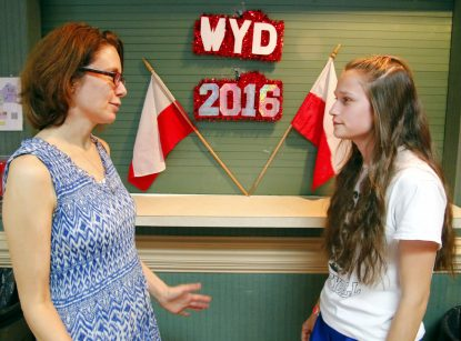 Beth Riordan (left), the archdiocesan leader of the group traveling to Poland for World Youth Day July 26-31, chats with Clare Stoyell-Mulholland who spent two years raising money for World Youth Day, including through bake sales at her parish, St. Mary Magdalen in Media.