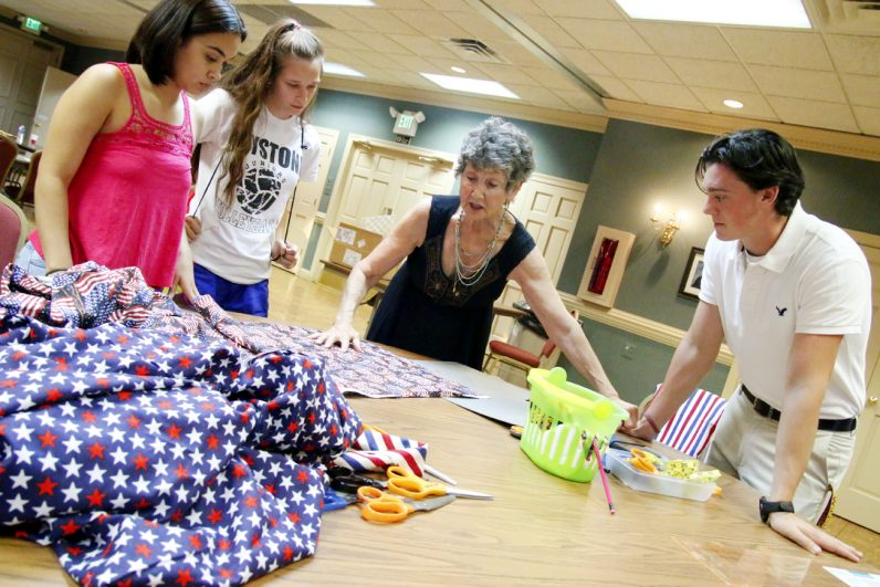 Material is cut to make bandanas and scarves for World Youth Day.