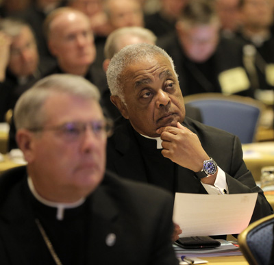 Atlanta Archbishop Wilton D. Gregory, center, listens to a speaker Nov. 16 during the opening of the 2015 fall general assembly of the U.S. Conference of Catholic Bishops in Baltimore. (CNS photo/Bob Roller)