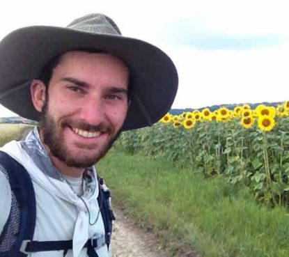 Andrew Dierkes stops to admire the flowers along a country road in central Europe.