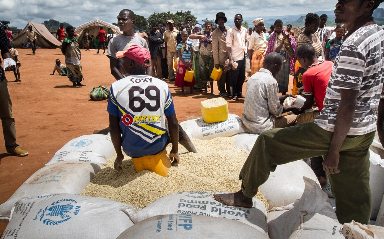 Refugees wait for food rations from the United Nations in early February at a camp in Mwanza, Malawi. In Malawi, where 40 percent of the population needs food aid, the country's bishops have called for international help to avert a crisis. (CNS photo/Erico Waga, EPA)