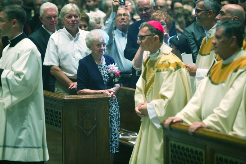 During the entrance procession Bishop Deliman acknowledges his family including his mother, Margaret. (Bradley Digital)