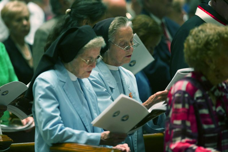 Two Sisters, Servants of the Immaculate Heart of Mary participate in the Mass. (Bradley Digital)