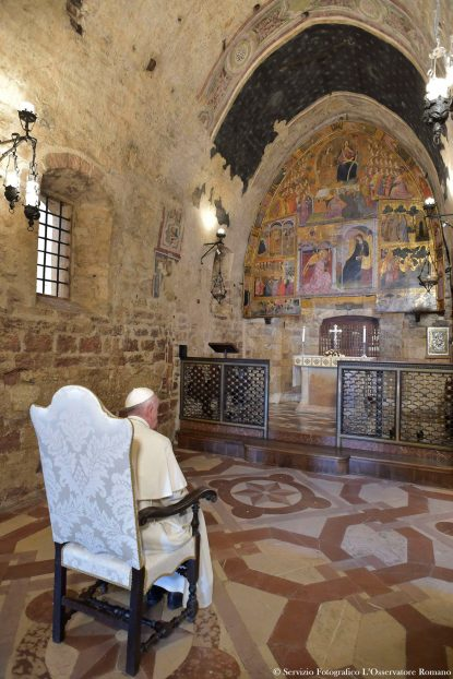 Pope Francis prays in the Portiuncola, the chapel inside the Basilica of St. Mary of the Angels, in Assisi, Italy, Aug. 4. (CNS photo/L'Osservatore Romano via Reuters)