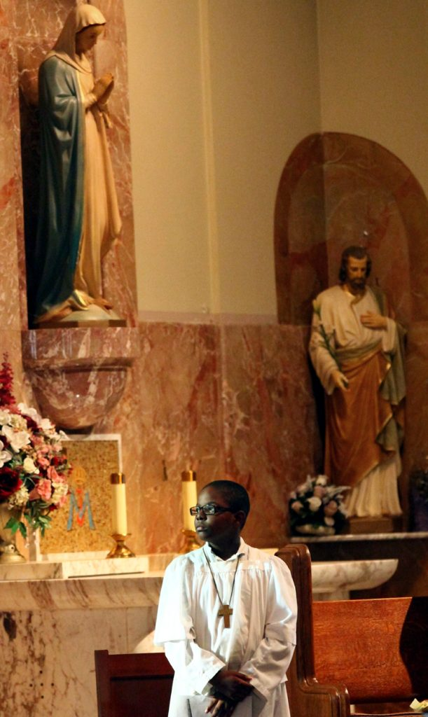 Altar server Hedwig Dorismond