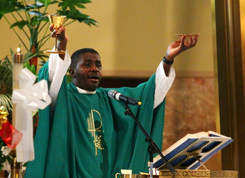 Father Alfred Lauricien, O.M.I., celebrates Mass in Haitian Creole at St. William Church in Northeast Philadelphia.