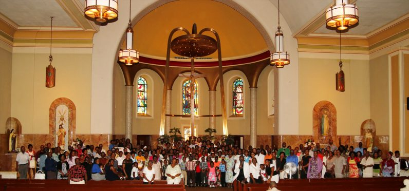 The Haitian Catholic community at St. William's poses for a photo after Mass.