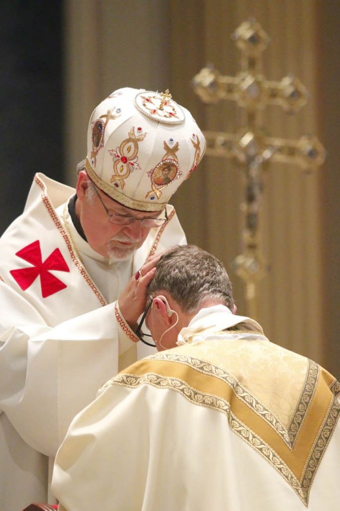 Ukrainian Archbishop of Philadelphia Stefan Soroka lays hands on the new bishop. (Sarah Webb)
