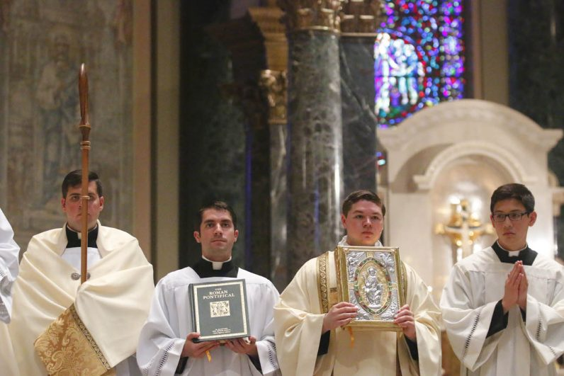 Seminarians performed many roles of service for the Mass in the cathedral. (Sarah Webb)