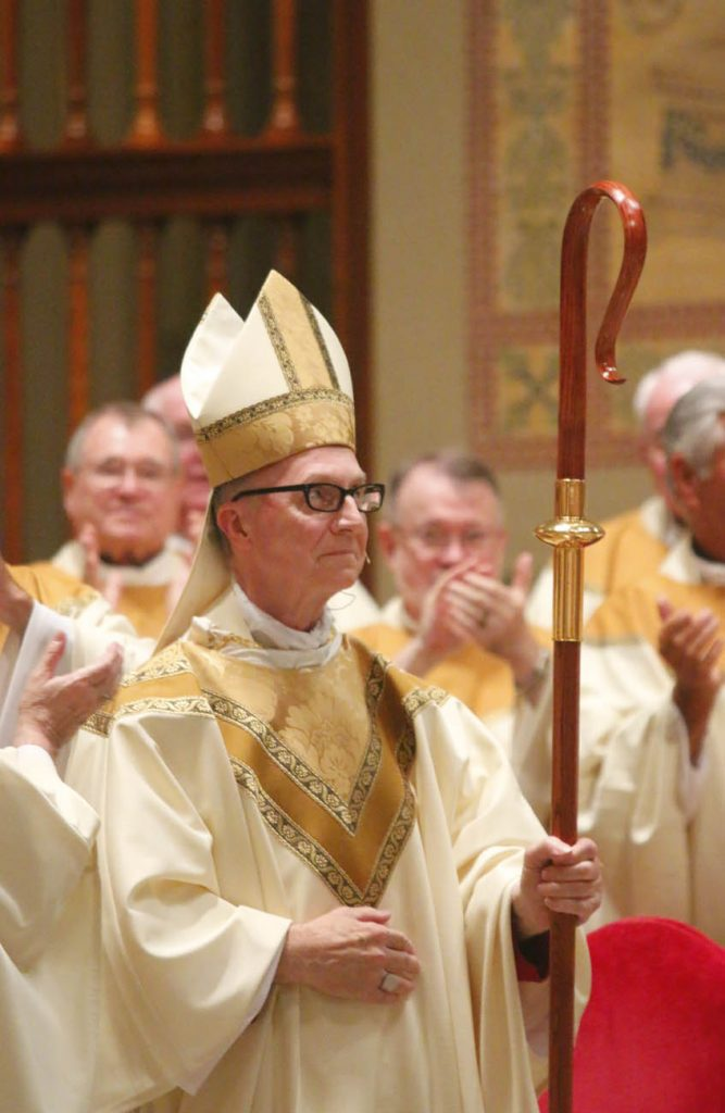 Bishop Deliman acknowledges the applause. (Sarah Webb)