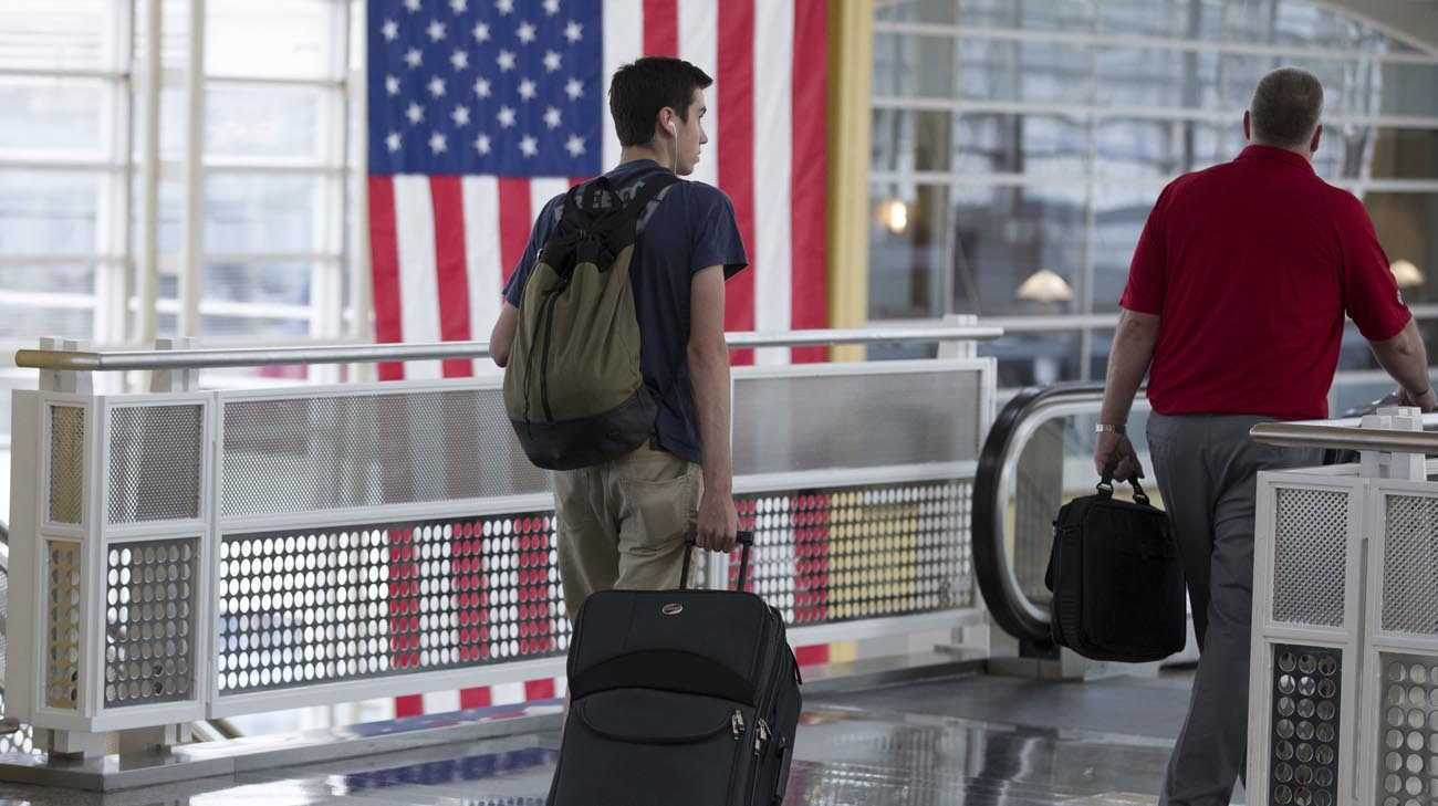 Travelers are seen June 30 at Ronald Reagan Washington National Airport in the Washington suburb of Arlington, Va. (CNS photo/Michael Reynolds, EPA)