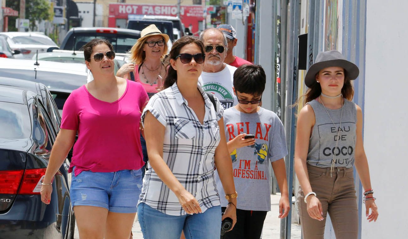 Visitors walk through the Wynwood arts district of Miami Aug. 3. During the first week of August, the Florida Department of Health reported its 16th case of locally transmitted Zika virus in a one-square-mile area of Miami north of downtown, bringing the total number of people infected in the mosquito-borne outbreak to at least 16.(CNS photo/Joe Skipper, Reuters)