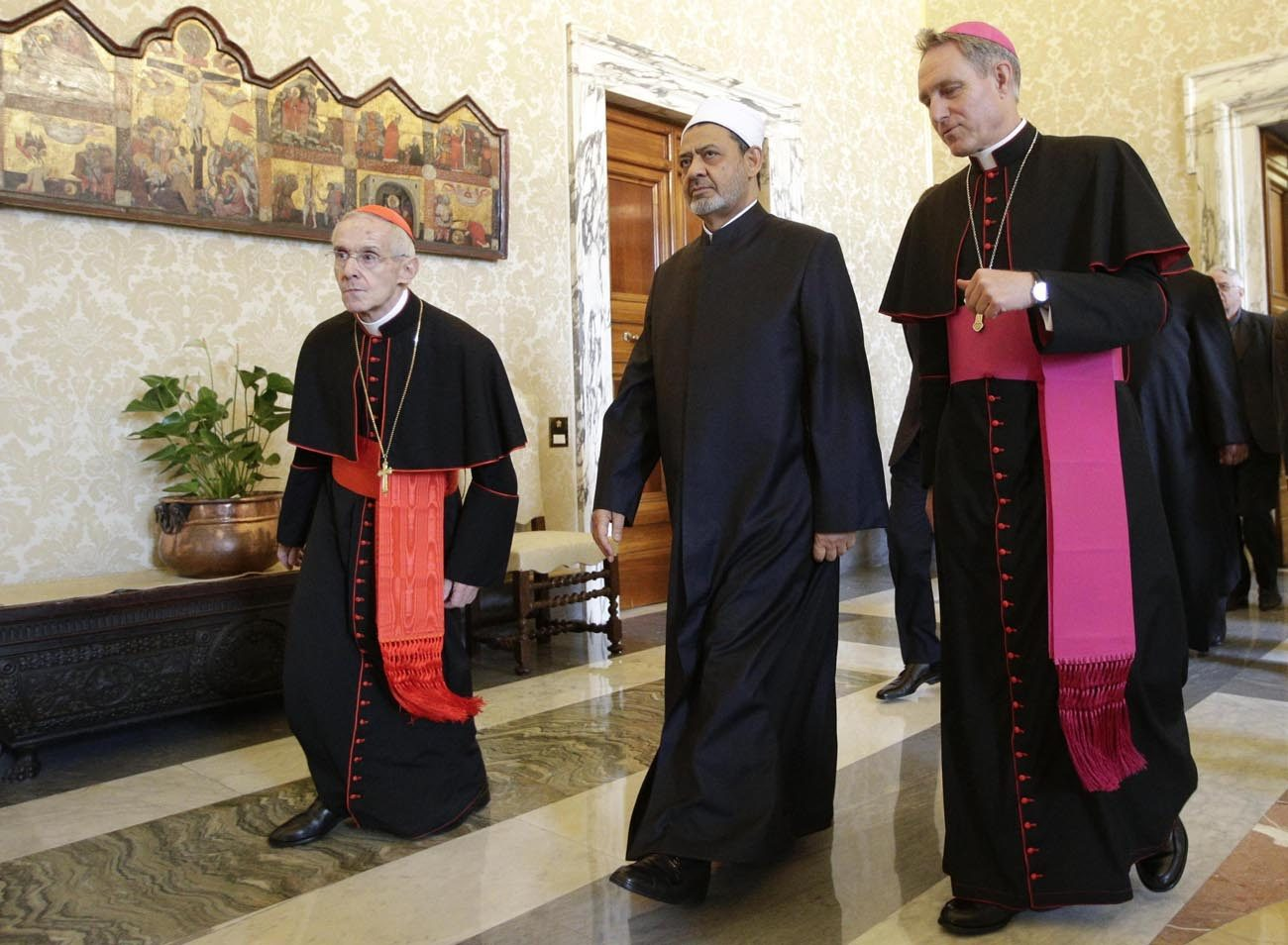 Cardinal Jean-Louis Tauran, left is seen Sheik Ahmad el-Tayeb, grand imam of al-Azhar mosque and university, and Archbishop Georg Gaenswein at the Vatican May 23. The French cardinal said terrorists want to make peace-loving Christians and Muslims believe that it is impossible for them to live side by side; it is up to Christians and Muslims to prove them wrong. (CNS photo/Reuters pool via EPA)
