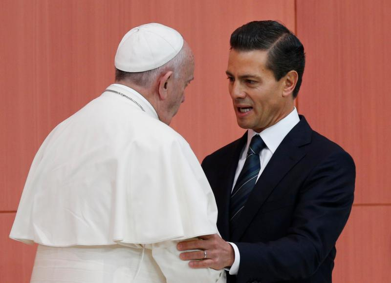 Pope Francis talks with Mexican President Enrique Pena Nieto during  visit to Mexico City in early February. A Catholic university said Pena Nieto met the requirements for graduation with a law degree, while acknowledging parts of his 1991 thesis were plagiarized. (CNS photo/Paul Haring)
