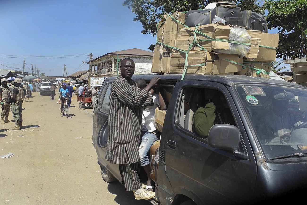 Nigerians are seen packed in a van fleeing Mubi, Nigeria, following attacks in 2014. Boko Haram has claimed responsibility for scores of attacks on churches and mosques, often killing worshippers during religious services or immediately afterward.(CNS photo/EPA)