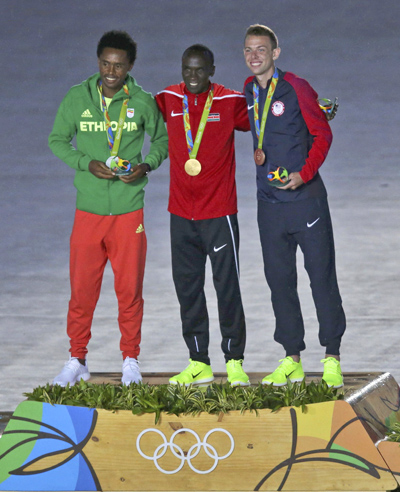 Silver medalist Feyisa Lilesa of Ethiopia, gold medalist Eliud Kipchoge of Kenya and bronze medalist Galen Rupp of the U.S., pose Aug. 22, a day after competing in the men's marathon event in the Olympics in Rio de Janeiro.(CNS photo/Marcos Brindicci, Reuters)