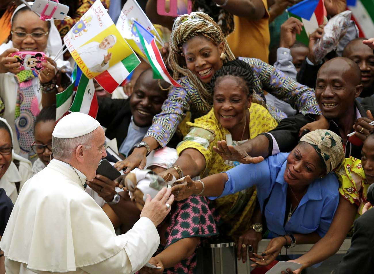 Pope Francis greets the faithful as he arrives to lead his general audience in Paul VI hall at the Vatican Aug. 10. (CNS photo/Max Rossi, Reuters)