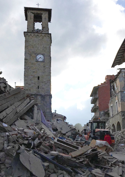 The partially damaged tower bell with the clock signaling the time of the earthquake is seen in Amatrice, Italy, Aug. 24. (CNS photo/Emiliano Grillotti, Reuters)