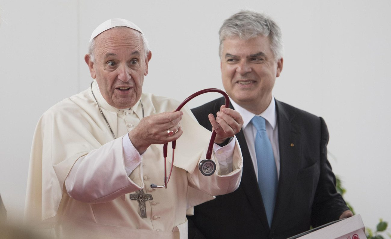 Pope Francis receives a stethoscope from the President of the European Society of Cardiology, Fausto Pinto, as he attends the World Congress of the European Society of Cardiology  Aug. 31 in Rome. (CNS photo/Maurizio Brambatti, EPA)