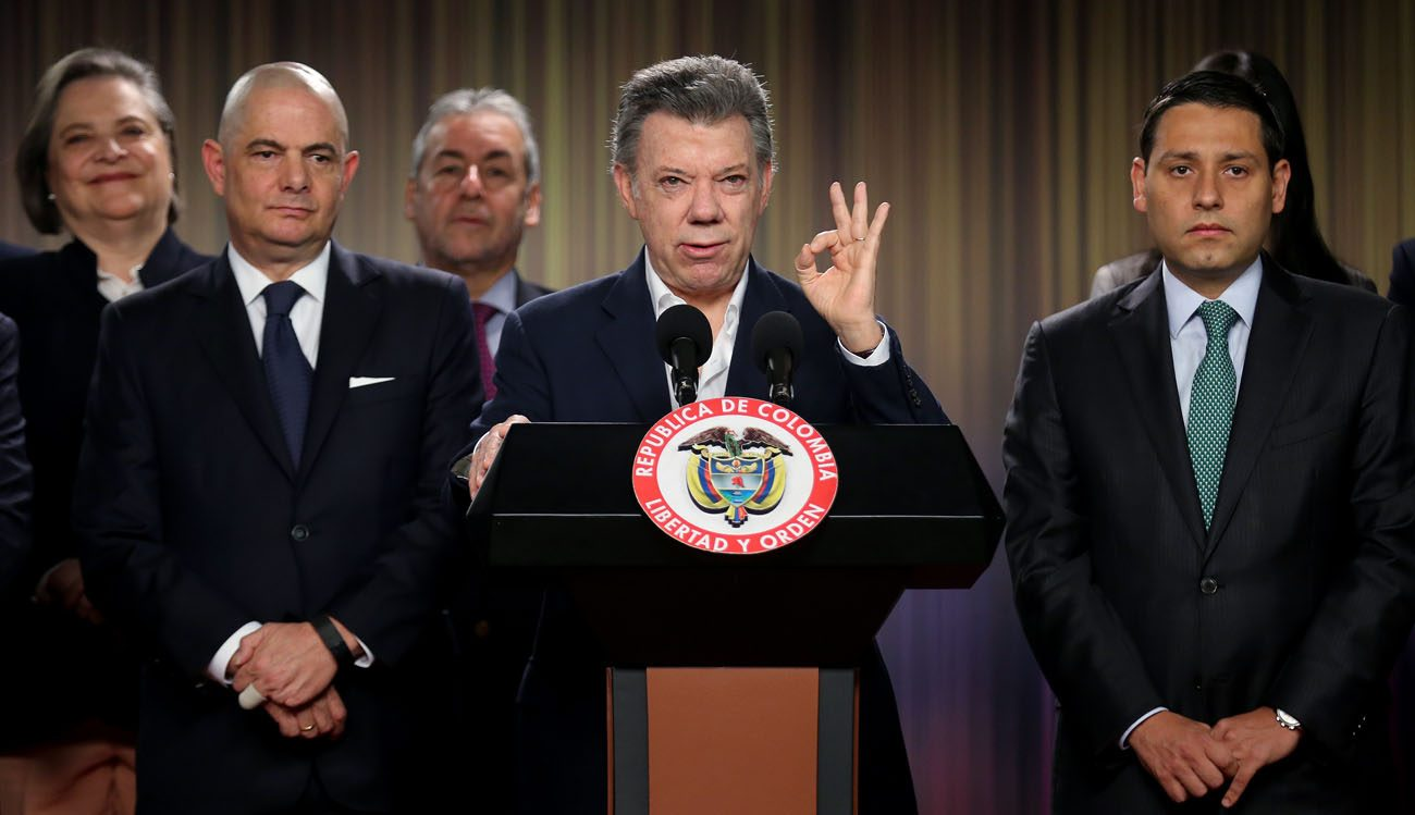 Colombian President Juan Manuel Santos gestures as he speaks Aug. 30 at the Palacio de Narino in Bogota, after he signed a document setting up a referendum on the peace agreement signed with the Revolutionary Armed Forces of Colombia, or FARC rebels. (CNS photo/Leonardo Munoz, EPA)