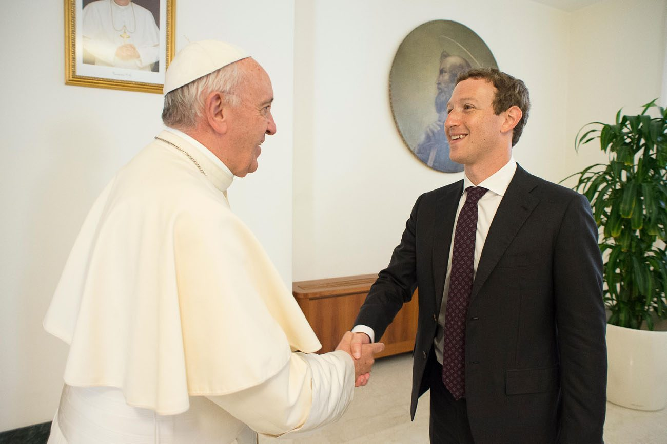 Pope Francis meets Mark Zuckerberg, CEO of Facebook, during a private audience at the Vatican Aug. 29. (CNS photo/L'Osservatore Romano, handout)