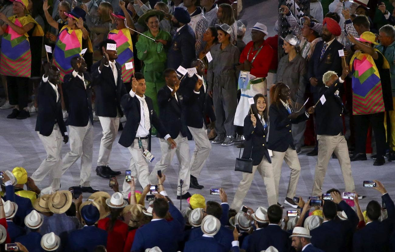 The new Refugee Olympic Team arrives for the opening ceremony in Rio de Janeiro Aug. 5. In a personal message addressed to each of the 10 members of the new Refugee Olympic Team, Pope Francis wished them success in their events and thanked them for the witness they are giving the world. (CNS photo/David Gray, Reuters)