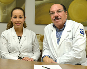 Dr. Catherine Diaz Montijo, an epidemiologist, and Dr. Ramon Ramirez Ronda, a pathologist, pose for a photo at Hospital de la Concepcion in San German, Puerto Rico, Aug. 16. (CNS photo/CNS photo/Wallice J. de la Vega)