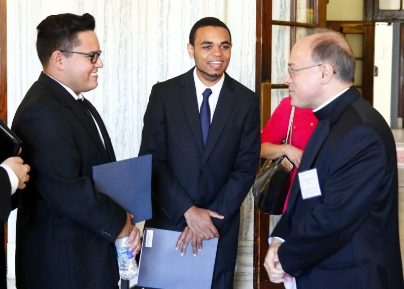 Father Joseph Shenosky (right), vice rector of the St. Charles' College Division, chats with new men arriving at the seminary.