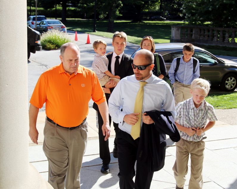 Aaron Scheidel (center rear) from St. Benedict Parish in Mohnton, Allentown Diocese, arrives at the seminary with his family.