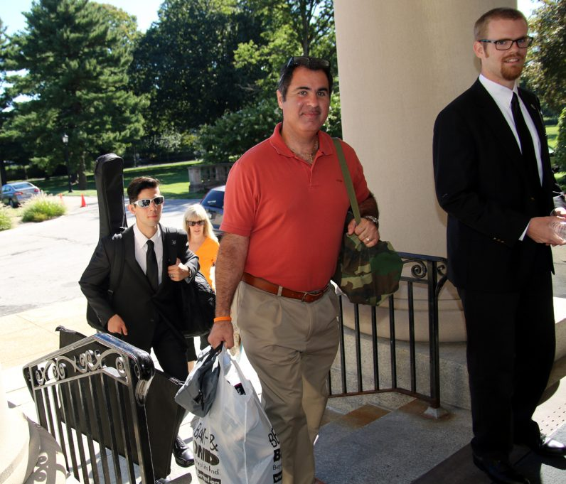 Mike Speranza helps carry the bags of his son Ben (left) as other seminarians move in to the seminary as well.