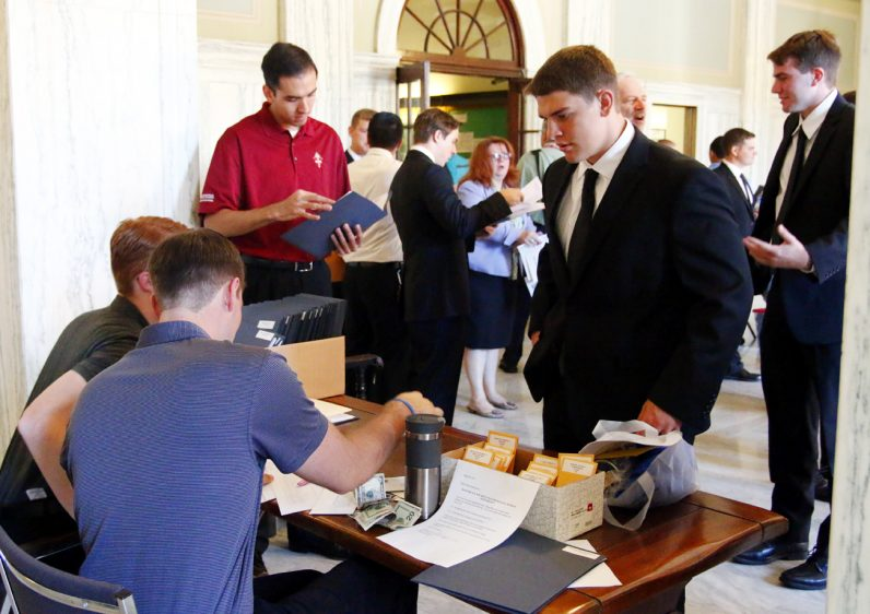 New seminarians confirmed their arrival with current seminarians manning a check-in table.