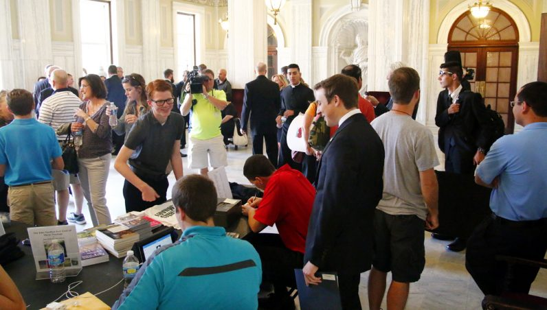 Joined by parents and their families, new seminarians moved in their gear and confirmed their arrival Aug. 23 with current seminarians manning a check-in table at St. Charles Borromeo Seminary. (Photo by Sarah Webb)
