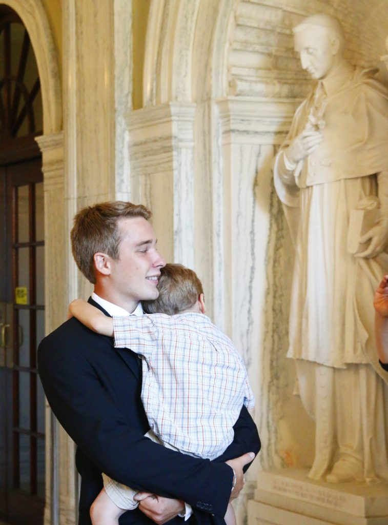 Aaron Scheidel, a new seminarian from the Allentown Diocese, gets one last hug from his little brother Eli as he begins his studies at the seminary.