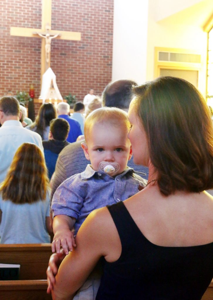 Luke Owen attends Mass with his mother Lisa, father Garrett and sister Molly (not shown).