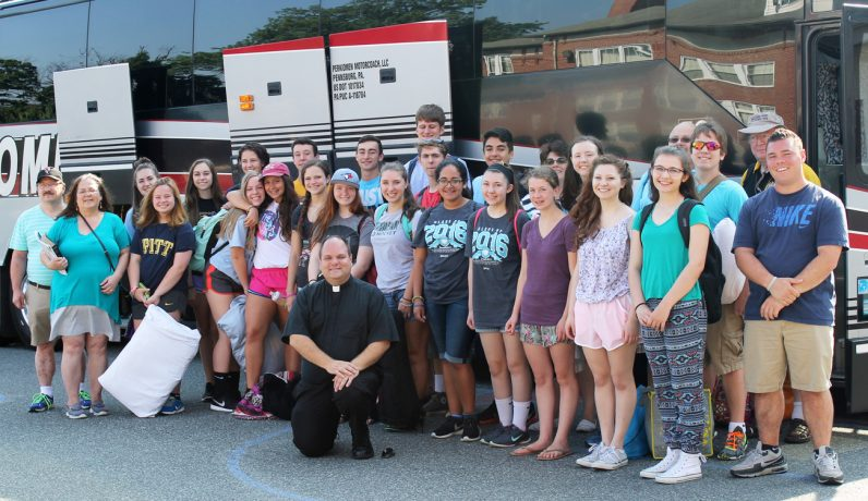 Father Stephen Paolino , center, led the group of teenagers from St. Aloysius Parish, Pottsown, at the Franciscan University youth conference.