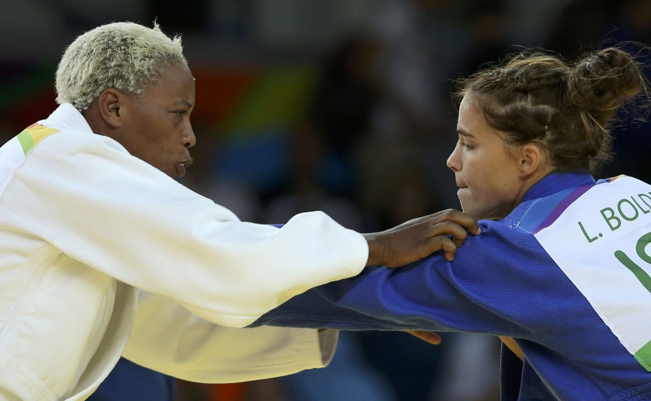 Refugee Olympic Team's Yolande Mabika, left, and Linda Bolder of Israel compete in judo during the Summer Olympics in Rio de Janeiro Aug. 10. (CNS photo/Toru Hanai, Reuters)