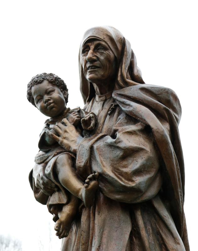 A statue of Blessed Teresa of Kolkata holding a child is seen in a prayer garden at Cure of Ars Church in Merrick, N.Y. On Sept. 4, Pope Francis, who has spent this year preaching about mercy, will canonize Mother Teresa, who traveled the world to deliver a single message: that love and caring are the most important things in the world. (CNS photo/Gregory A. Shemitz)