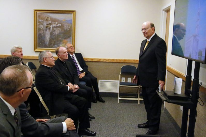 Elder Quentin Cook (right), one of the Quorum of the Twelve Apostles of the Church of Jesus Christ of Latter-Day Saints, welcomes Archbishop Charles Chaput, Auxiliary Bishop Michael Fitzgerald, fellow archdiocesan priests and other guests at the new Mormon Temple. (Sarah Webb)