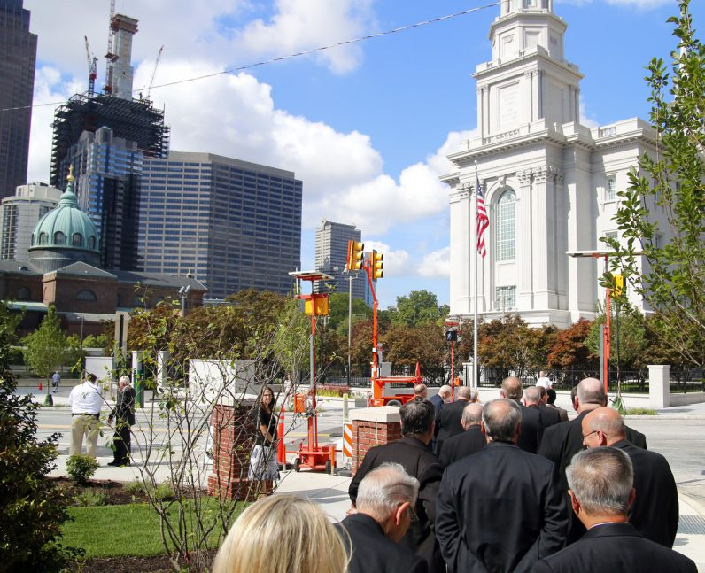 The contigent from the archdiocese walks to the temple from the new Mormon community center, located across 17th street, where the group was first welcomed and shown an informational video. The Cathedral Basilica of SS. Peter and Paul, left, is about  a block away.