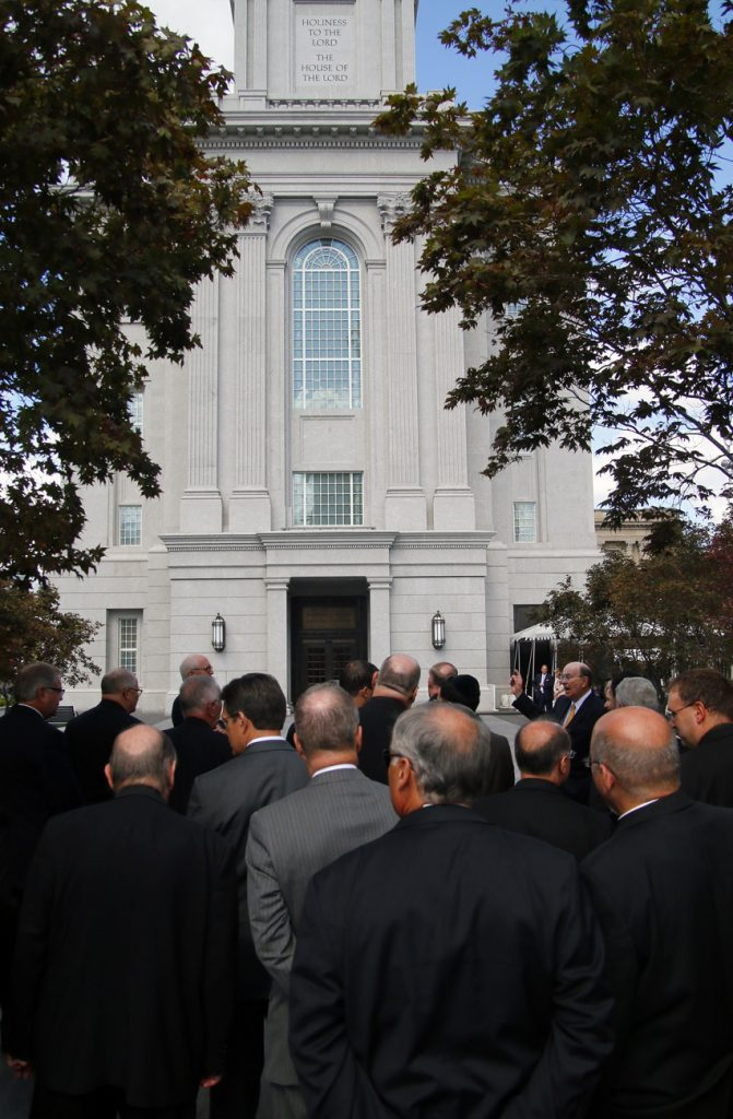 Elder Quentin Cook (right), one of the Quorum of the Twelve Apostles of the Church of Jesus Christ of Latter-Day Saints, describes the new temple for his archdiocesan visitors. (Sarah Webb)