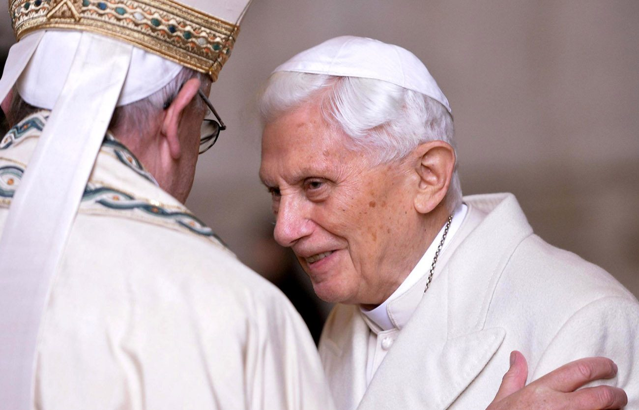 Pope Francis greets retired Pope Benedict XVI prior to the opening of the Holy Door of St. Peter's Basilica at the Vatican in 2015. Although retired Pope Benedict is growing more frail, there are no particular concerns or worries regarding his health, a Vatican spokesman said. (CNS photo/Maurizio Brambatti, EPA)