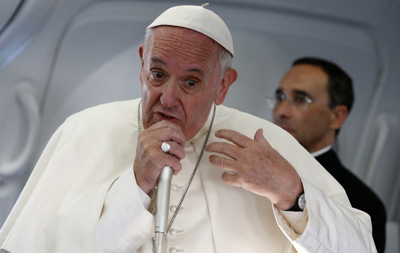 Pope Francis speaks with journalists aboard his July 31 flight from Krakow, Poland, to Rome. (CNS photo/Paul Haring)