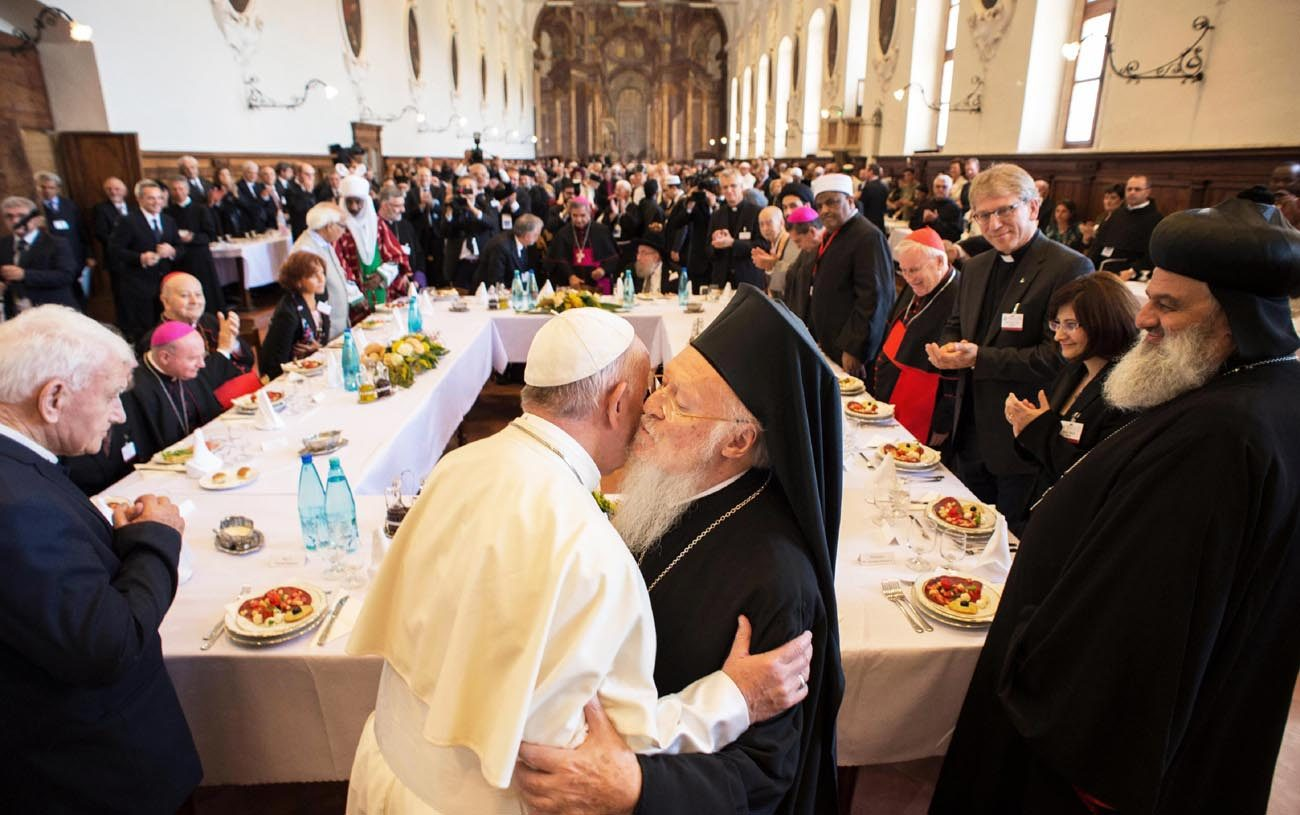 Pope Francis is greeted by Ecumenical Patriarch Bartholomew of Constantinople during an interfaith peace gathering Sept. 20 at the Basilica of St. Francis in Assisi, Italy. The peace gathering marks the 30th anniversary of the first peace encounter in Assisi. (CNS photo/L'Osservatore Romano handout via Reuters)
