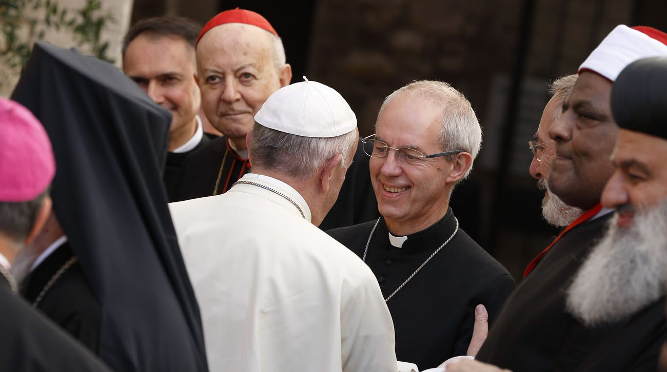 Pope Francis exchanges greetings with Anglican Archbishop Justin Welby of Canterbury, England, spiritual leader of the Anglican Communion, as he arrives for an interfaith peace gathering at the Basilica of St. Francis in Assisi, Italy, Sept. 20. The peace gathering marks the 30th anniversary of the first peace encounter in Assisi in 1986. (CNS photo/Paul Haring)