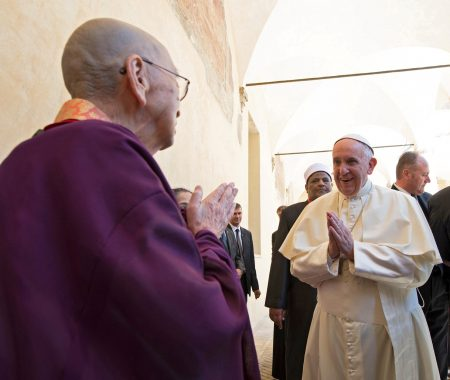 Pope Francis gestures as he arrives for an interfaith peace gathering at the Basilica of St. Francis in Assisi, Italy, Sept. 20. (CNS photo/L'Osservatore Romano handout via Reuters)