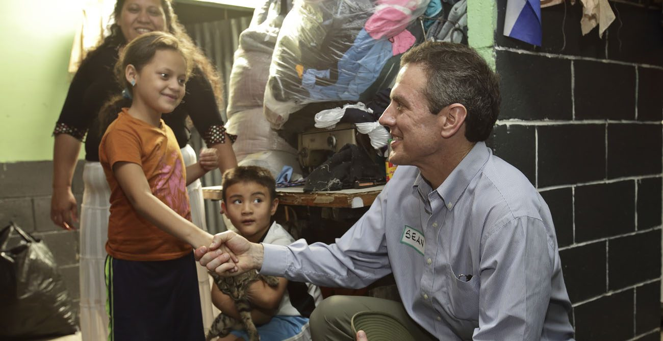 Sean Callahan, the new CEO of Catholic Relief Services, one of the largest humanitarian relief agencies in the world, is seen greeting children in an undated photo in El Salvador.  His new position begins Jan. 1, when he succeeds Carolyn Y. Woo, who ends her five-year term at the end of 2016. (CNS photo/Oscar Leiva, Silverlight for CRS)