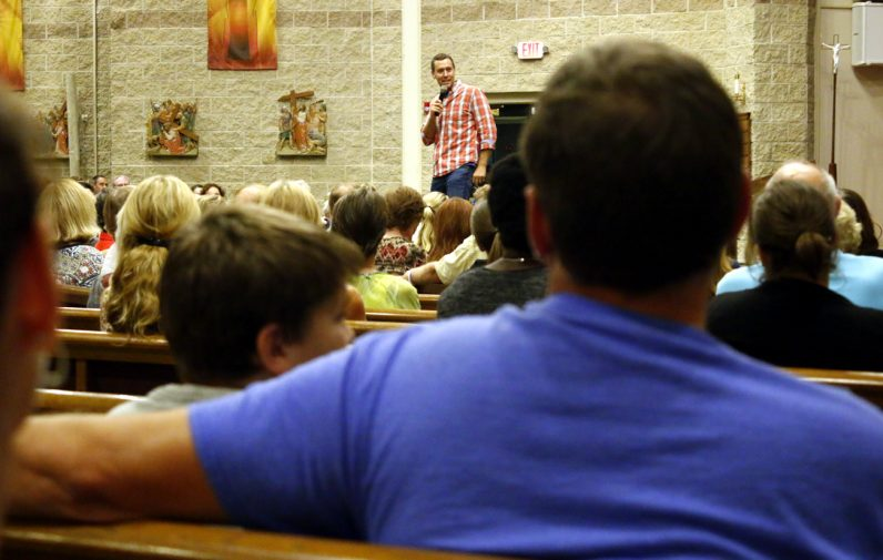 People of all ages including parents and their children attended Chris Stefanick's presentation at St. Martin of Tours Church in New Hope.