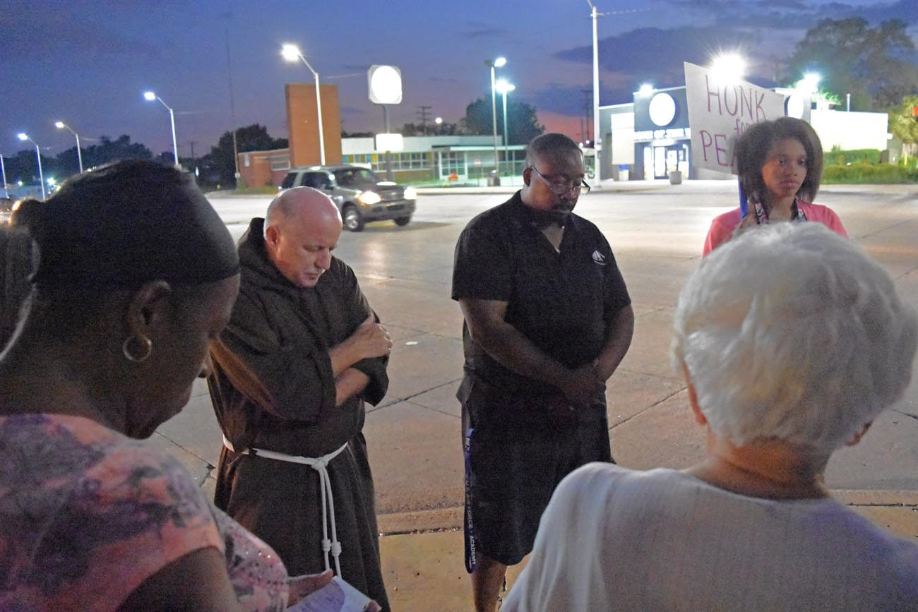 Parishioners from several Detroit parishes gather Aug. 25 to pray for peace, an effort organized by the Archdiocese of Detroit's Office of Black Catholic Ministries. (CNS photo/Dan Meloy, Michigan Catholic)